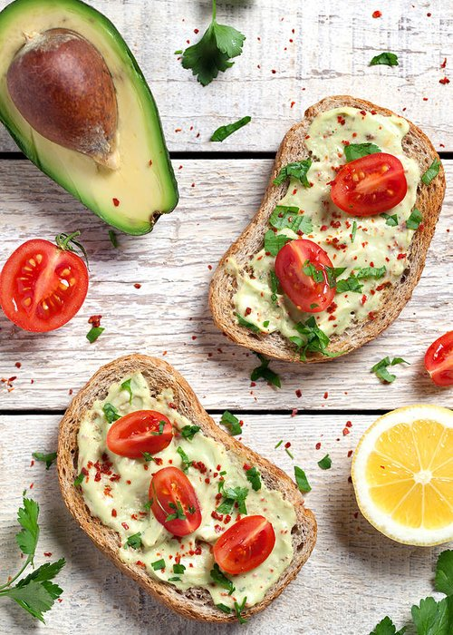 Breakfast Greeting Card featuring the photograph Healthy Whole Grain Bread With Avocado by Barcin