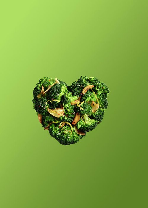 Broccoli Greeting Card featuring the photograph Heart Shaped Broccoli On Green by Maren Caruso