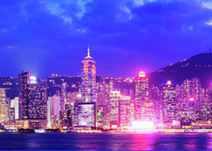 Downtown District Greeting Card featuring the photograph Hong Kong City Skyline In China by Deejpilot