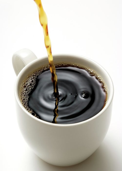 Breakfast Greeting Card featuring the photograph Isolated Shot Of Pouring A Fresh Coffee by Kyoshino