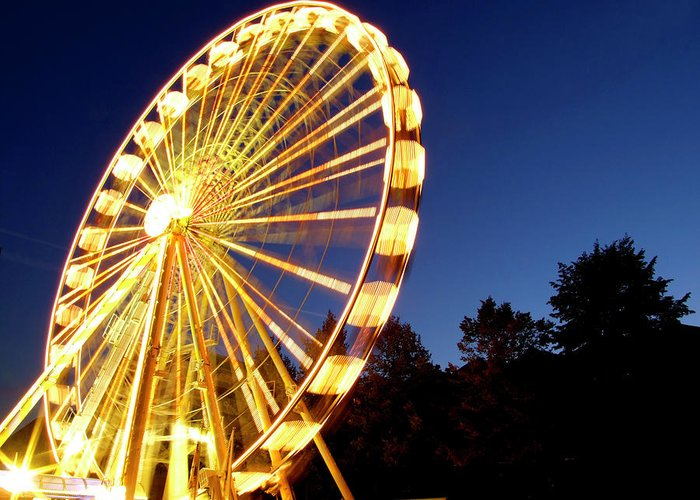 Curve Greeting Card featuring the photograph Lighted Ferris Wheel Spinning In Motion by Vfka