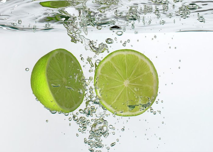 Vitamin C Greeting Card featuring the photograph Lime Halves Submerged In Water by Photoalto/neville Mountford-hoare