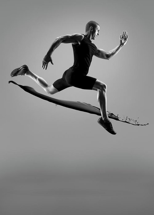 People Greeting Card featuring the photograph Male Athlete Running Above Liquid Splash by Jonathan Knowles