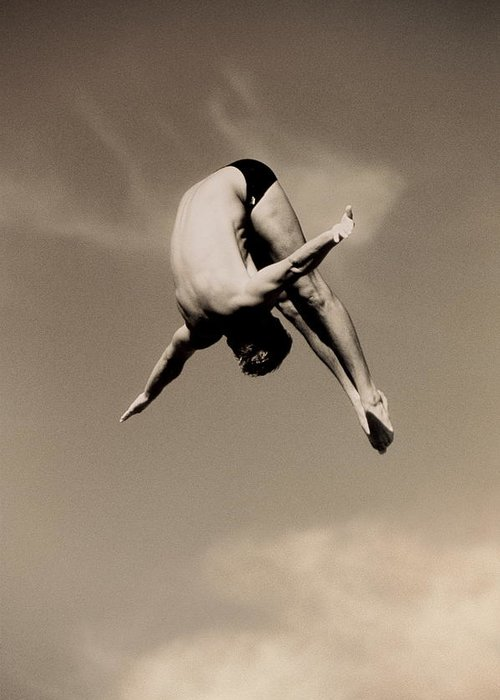 Diving Into Water Greeting Card featuring the photograph Male Diver In Mid-air by David Madison