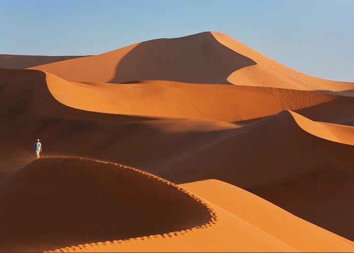Shadow Greeting Card featuring the photograph Man Climbing Sand Dunes, Namib Desert by Peter Adams