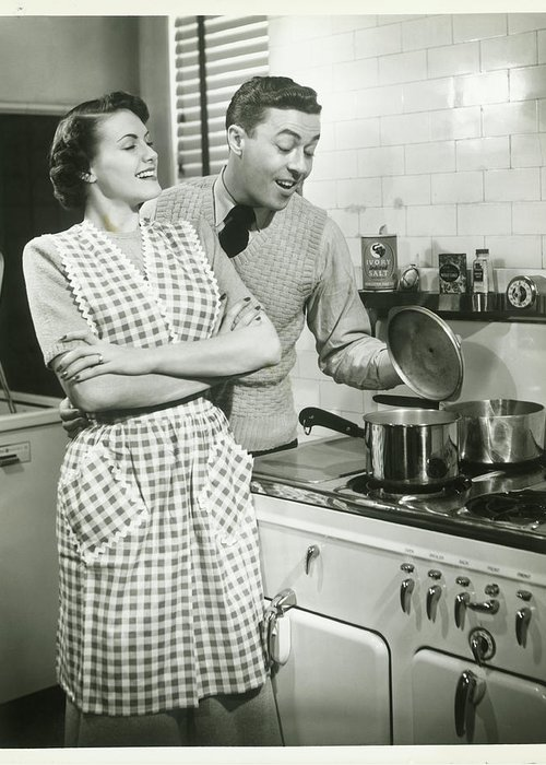 Heterosexual Couple Greeting Card featuring the photograph Man Looking Into Pot In Domestic by George Marks