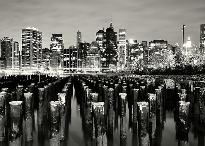 Wooden Post Greeting Card featuring the photograph Manhattan At Night by Shobeir Ansari