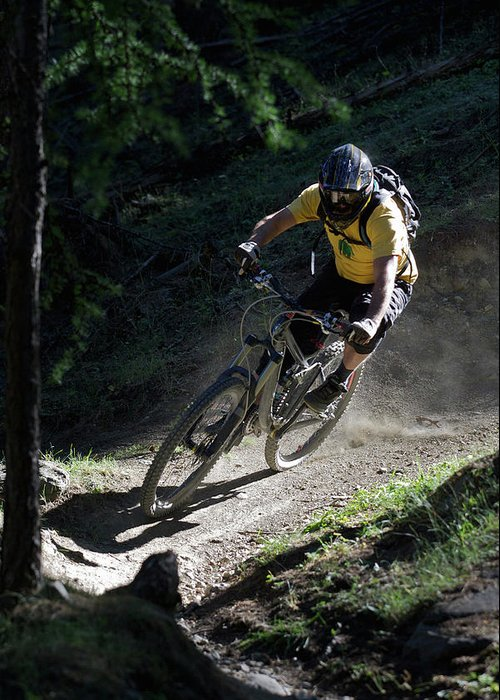 Sports Helmet Greeting Card featuring the photograph Mountain Biker On Dirt Path by Michael Truelove
