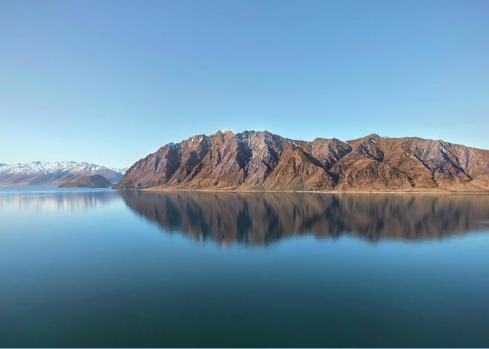 Scenics Greeting Card featuring the photograph Mountain Reflected On Lake Hawea by Verity E. Milligan