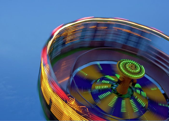 Carousel Greeting Card featuring the photograph Multicolored Spinning Carnival Ride by By Ken Ilio