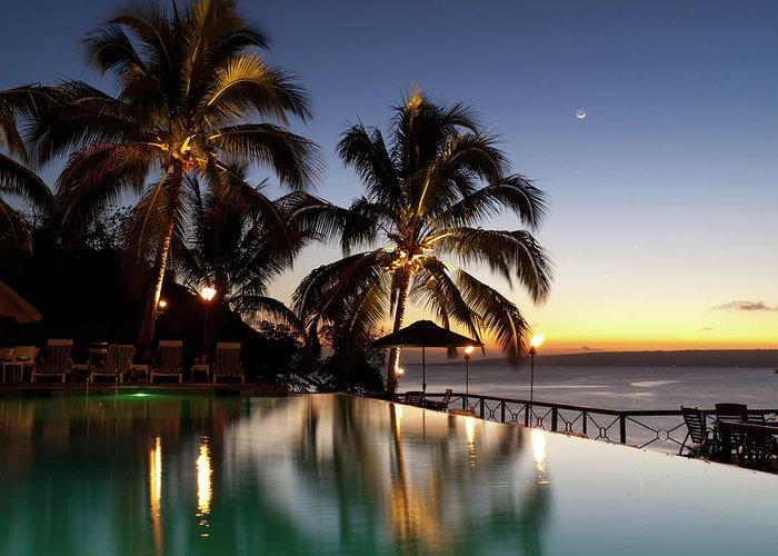 Swimming Pool Greeting Card featuring the photograph Nightfall At Iririki Island, Vanuatu by Holgs