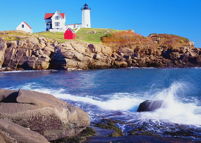 Water's Edge Greeting Card featuring the photograph Nubble Lighthouse And Coastine Of Maine by Ron thomas