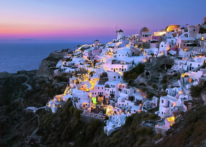 Greek Culture Greeting Card featuring the photograph Oia Lights At Sunset by Greg Gibb Photography