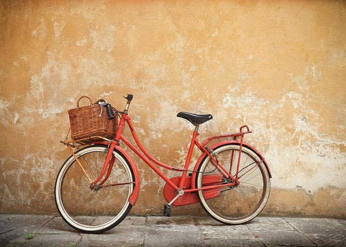Leaning Greeting Card featuring the photograph Old Red Bike Against A Yellow Wall In by Romaoslo