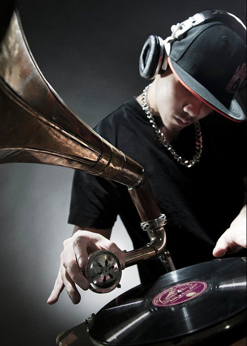 Youth Culture Greeting Card featuring the photograph Oriental Dj Using Old Gramophone To Mix by Justin Lambert