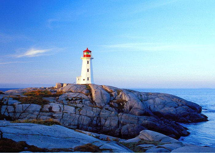 Water's Edge Greeting Card featuring the photograph Peggys Cove Lighthouse At Sunrise by Photorx