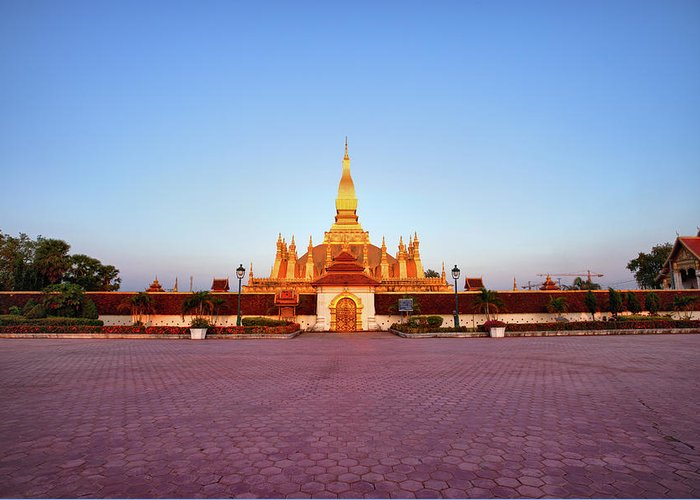 Monument Greeting Card featuring the photograph Pha That Luang Stupa At Sunset by Fototrav