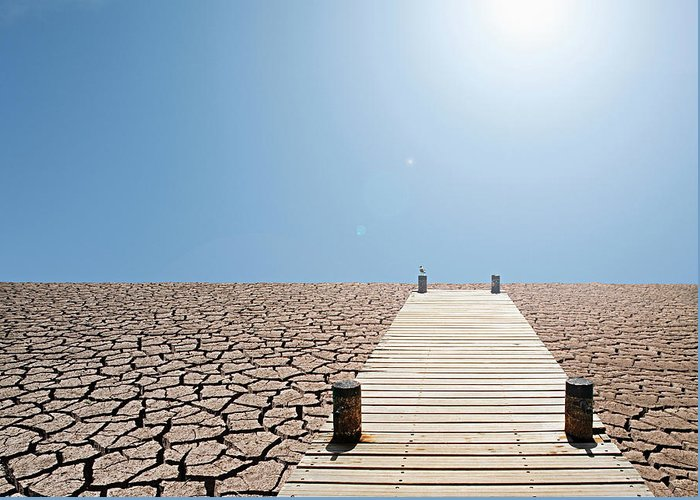 Environmental Damage Greeting Card featuring the photograph Pier Over A Dry Lake Bed by John Lund