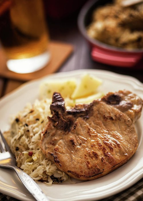 Meat Chop Greeting Card featuring the photograph Pork Chop And Sauerkraut by Gmvozd