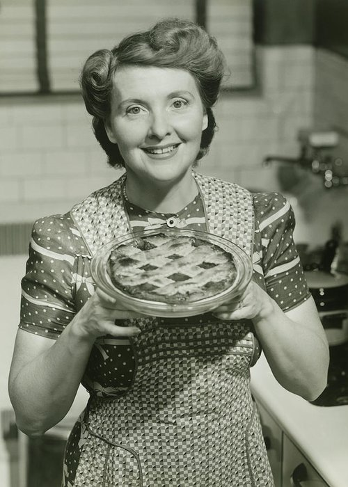 Mature Adult Greeting Card featuring the photograph Portrait Of Mature Woman Holding Pie by George Marks