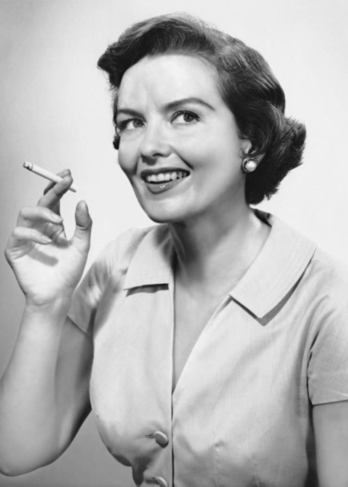 Smoking Greeting Card featuring the photograph Portrait Of Woman Holding Cigarettte by George Marks