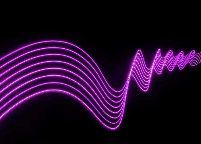 Laser Greeting Card featuring the photograph Purple Abstract Lights Trails And by John Rensten