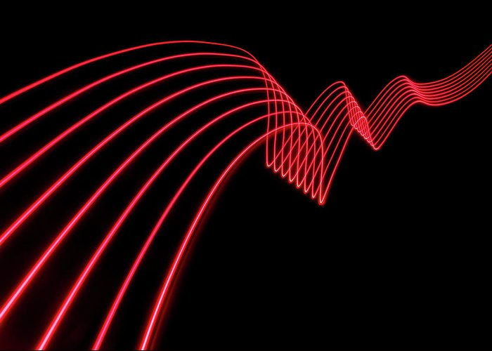 Laser Greeting Card featuring the photograph Red Abstract Coloured Lights Trails And by John Rensten
