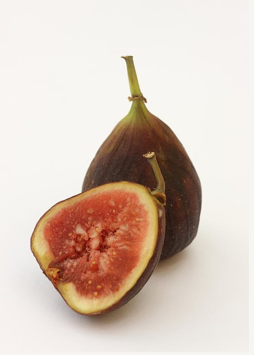 White Background Greeting Card featuring the photograph Ripe, Fresh Figs On White Background by Rosemary Calvert