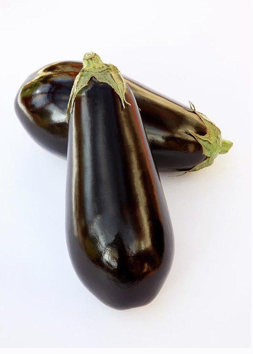 White Background Greeting Card featuring the photograph Ripe, Organic Aubergines On White by Rosemary Calvert