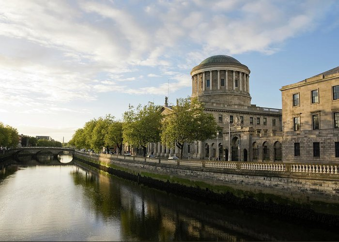 Dublin Greeting Card featuring the photograph River Liffey And The Four Courts In by Lleerogers