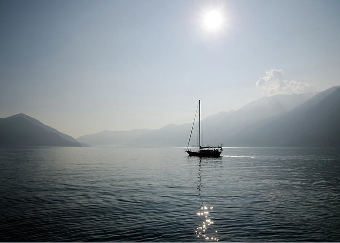 Sailboat Greeting Card featuring the photograph Sailing Boat In Alpine Lake by Mats Silvan