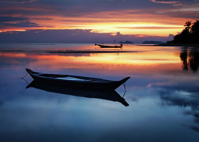 Scenics Greeting Card featuring the photograph Seashore With Longtail Boats At Sunset by Henrik Sorensen