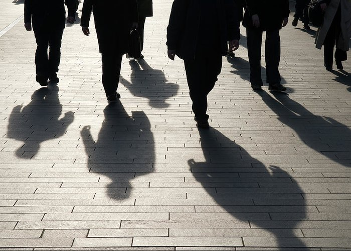 Shadow Greeting Card featuring the photograph Shadow Team Of Commuters Walking On by Peskymonkey