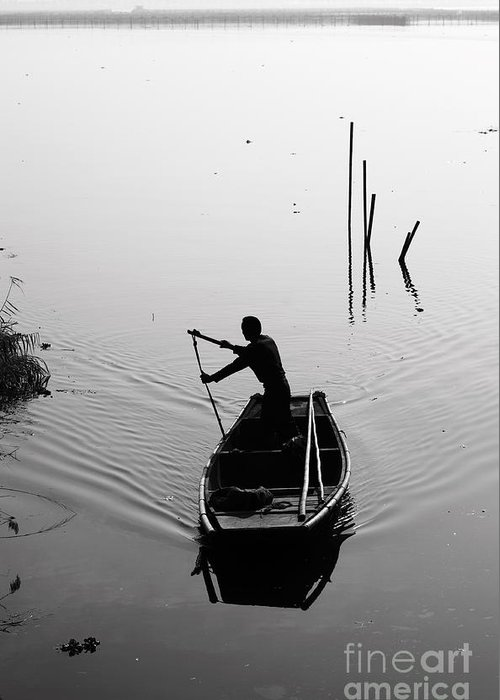 Boatman Greeting Card featuring the photograph Silhouette Of A Boatman Rowing A by Gwoeii