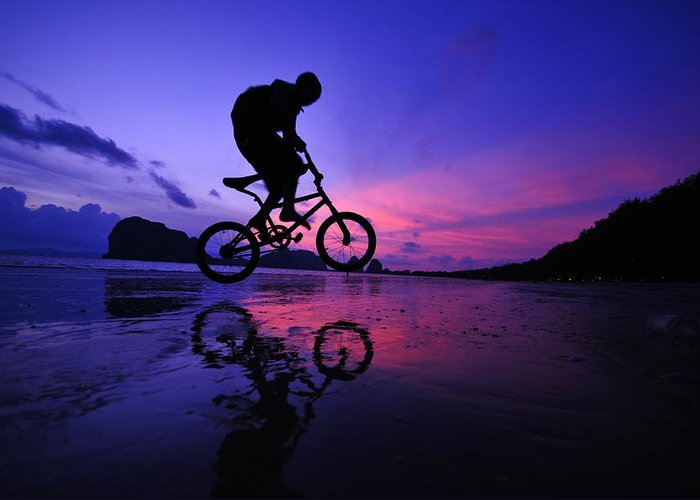 The Twilight Series Greeting Card featuring the photograph Silhouette Of A Mountain Biker On Beach by Primeimages