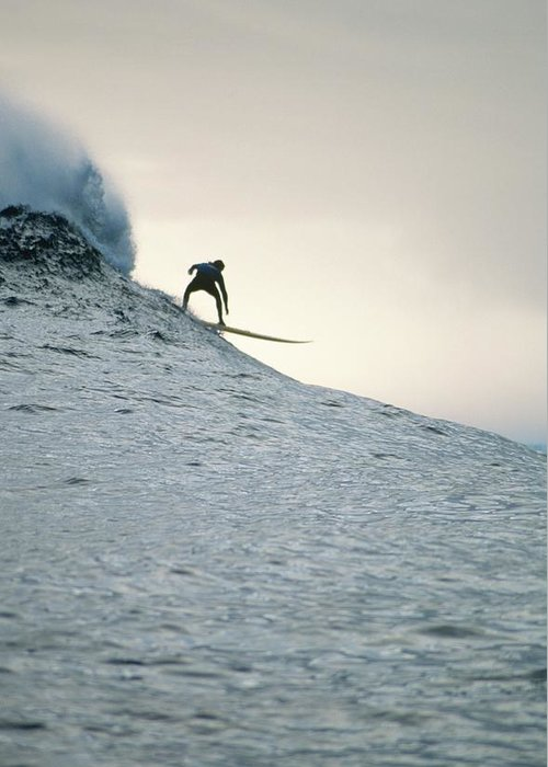 Scenics Greeting Card featuring the photograph Silhouette Of A Surfer Riding A Wave by Dominic Barnardt