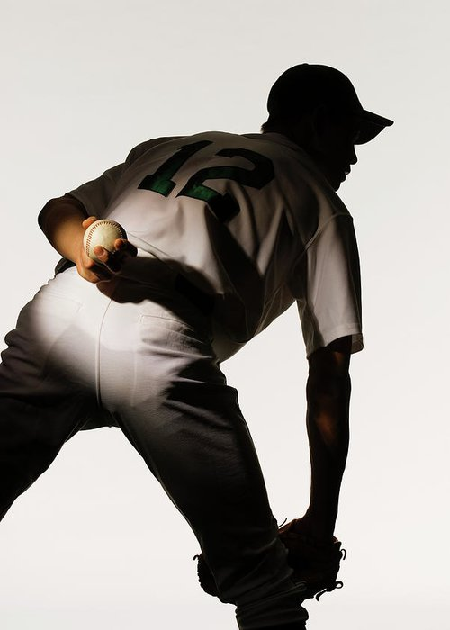 Three Quarter Length Greeting Card featuring the photograph Silhouette Of Baseball Pitcher Holding by Pm Images