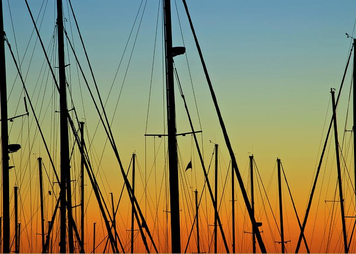 Sailboat Greeting Card featuring the photograph Silhouettes Of Sail Boat Masts And by Joseph Shields