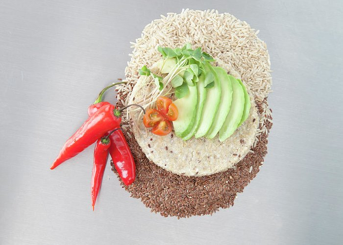 Flax Seed Greeting Card featuring the photograph Sliced Avocado And Peppers With Grains by Laurie Castelli