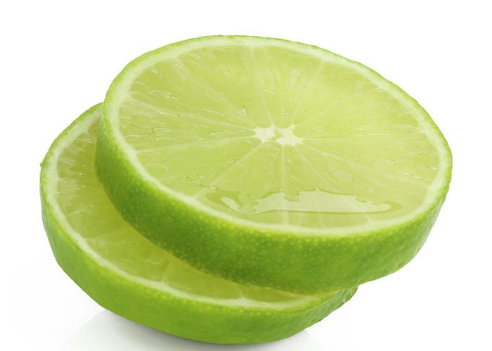 White Background Greeting Card featuring the photograph Slices Of Fresh, Juicy, Freshly Cut Lime by Rosemary Calvert