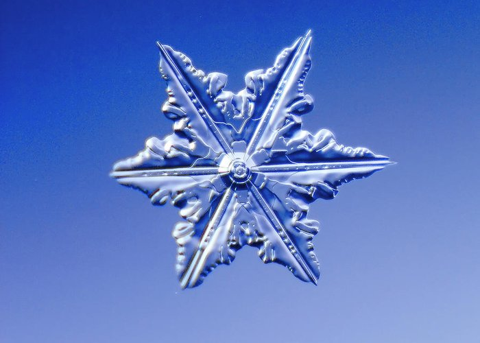 Snow Greeting Card featuring the photograph Snowflake On Blue Background by Fwwidall