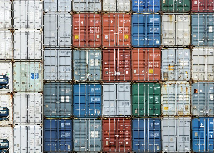 Trading Greeting Card featuring the photograph Stack Of Cargo Containers Full Frame by Andy Andrews
