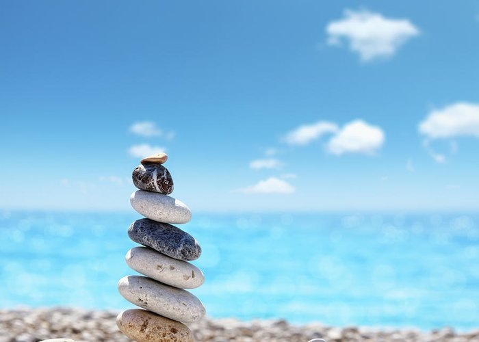 Water's Edge Greeting Card featuring the photograph Stone Balance On Beach by Imagedepotpro