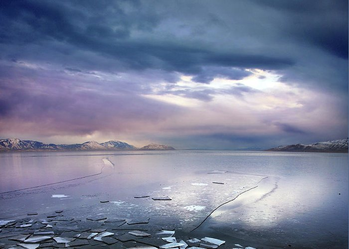 Scenics Greeting Card featuring the photograph Storm Clouds Clearing Over Icy Lake by Utah-based Photographer Ryan Houston