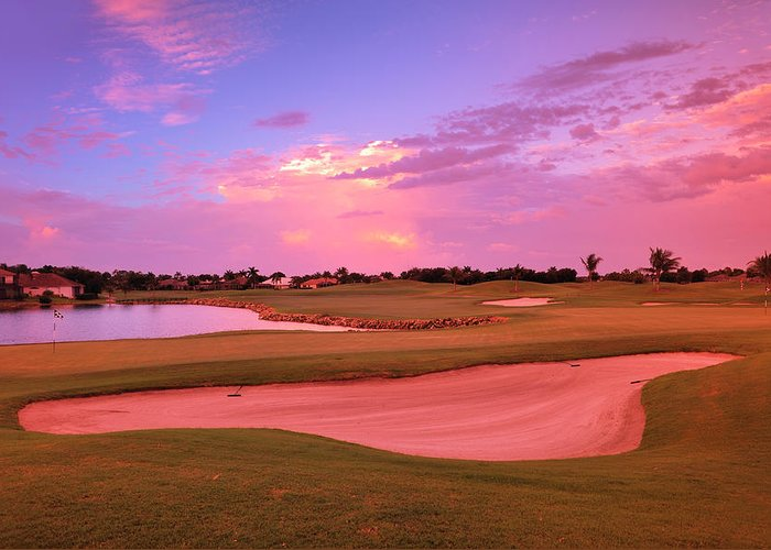 Sand Trap Greeting Card featuring the photograph Sunrise View Of A Resort On A Golf by Rhz