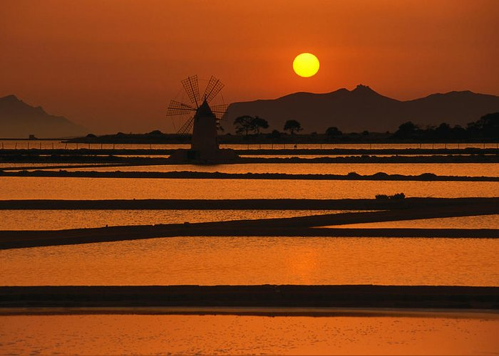 Environmental Conservation Greeting Card featuring the photograph Sunset Over The Saltpans And A Windmill by Dallas Stribley
