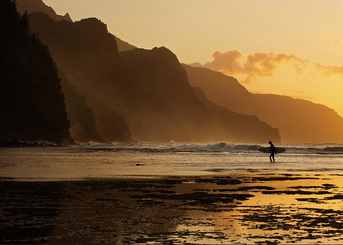 Tranquility Greeting Card featuring the photograph Surfer On Beach And Na Pali Coast Seen by Enrique R. Aguirre Aves