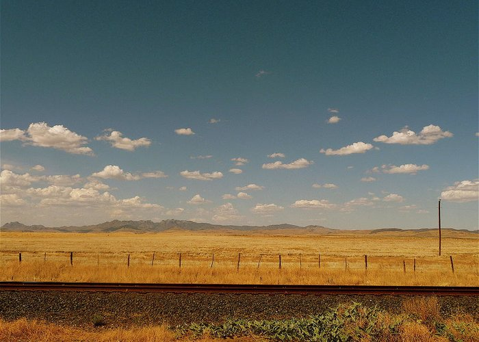 Tranquility Greeting Card featuring the photograph Texan Desert Landscape And Rail Tracks by Papilio