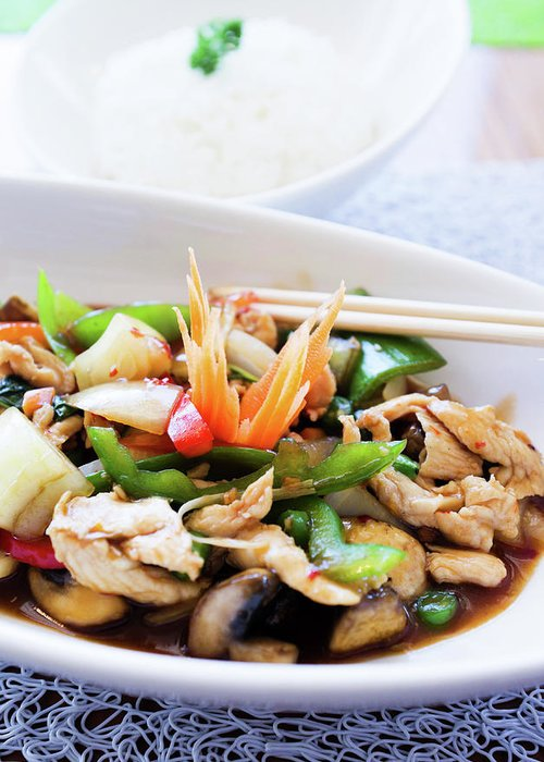 Chicken Meat Greeting Card featuring the photograph Thai Basil Chicken Dish And Bowl Of by Rapideye