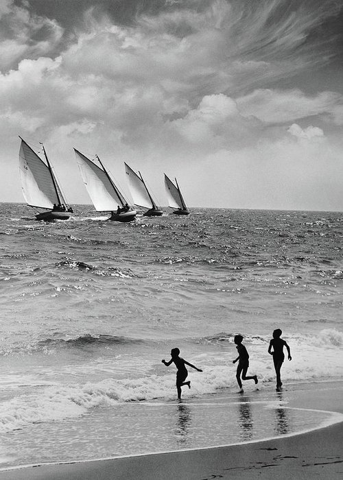 Following Greeting Card featuring the photograph Three Boys Running Along Beach by Stockbyte